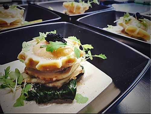 Lobster Ravioli, sautéed spinach, pickled fennel, shellfish sauce, caviar